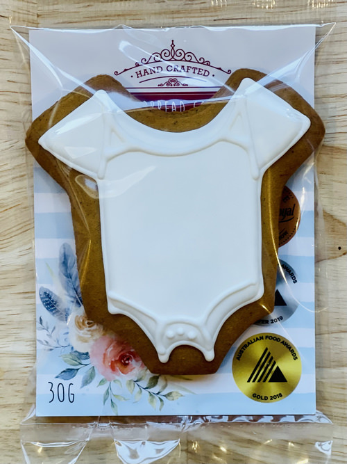 Adris white baby suit gingerbread   Sweet Arrivals baby hampers